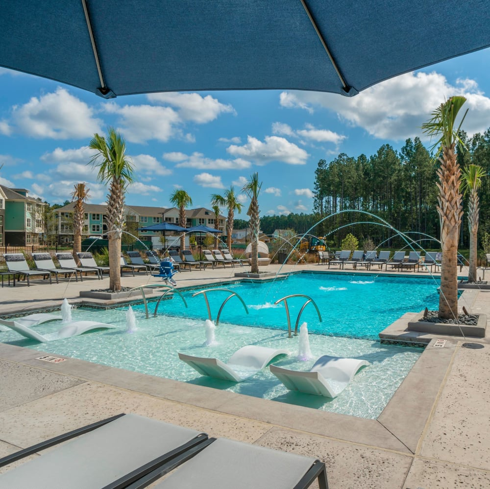Resort-style swimming pool with a sundeck and lounge chairs at Elevate at Brighton Park in Summerville, South Carolina