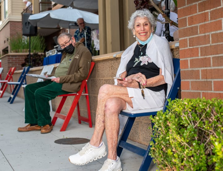 Bankers Hill residents take a seat after getting their booster shots.