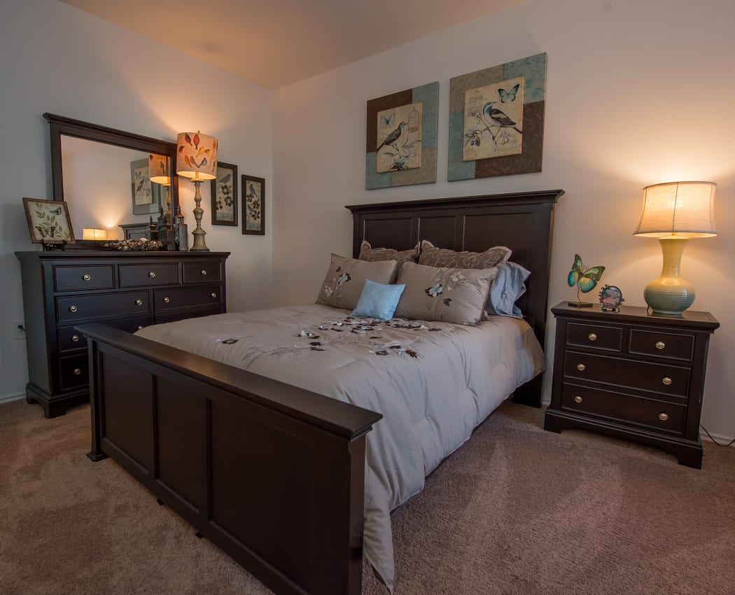 A well decorated bedroom at The Pointe of Ridgeland in Ridgeland, Mississippi