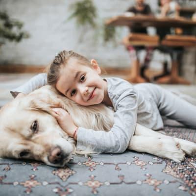 Girl cuddling her dog at Bellrock Upper North in Haltom City, Texas