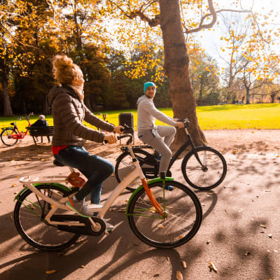 Resident couple riding bikes in park near Terra Apartment Homes in Federal Way, Washington