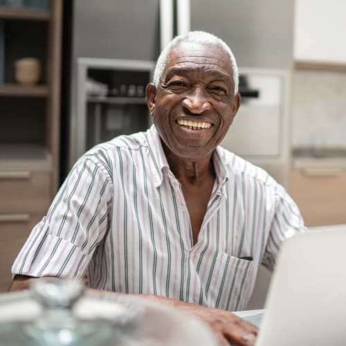 Resident at a computer at Chateau Brickyard in Salt Lake City, Utah.