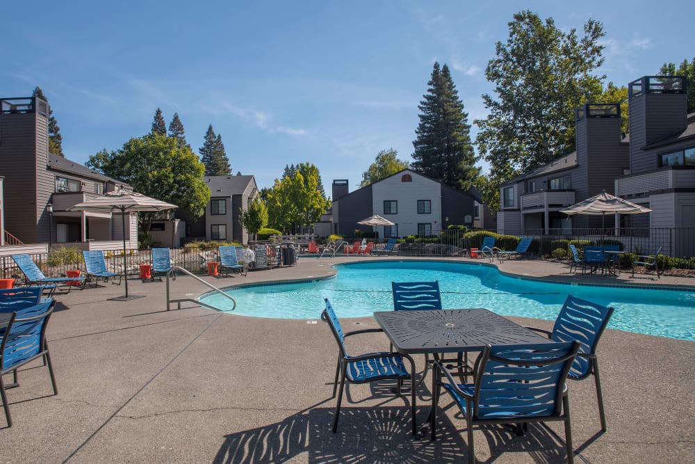 Swimming pool with a large sundeck at Hidden Lake Condominium Rentals in Sacramento, California