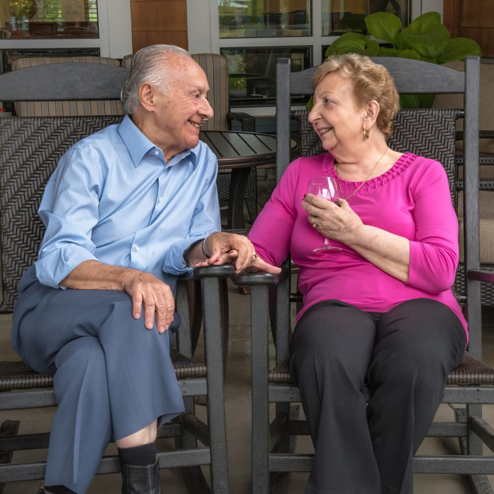 Two residents chatting on patio at The Springs at Sherwood in Sherwood, Oregon