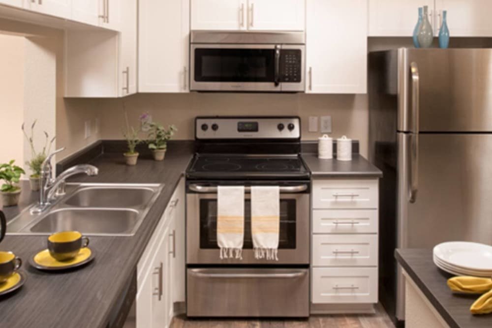 A Luxury apartment kitchen at Alize at Aliso Viejo Apartment Homes in Aliso Viejo, California