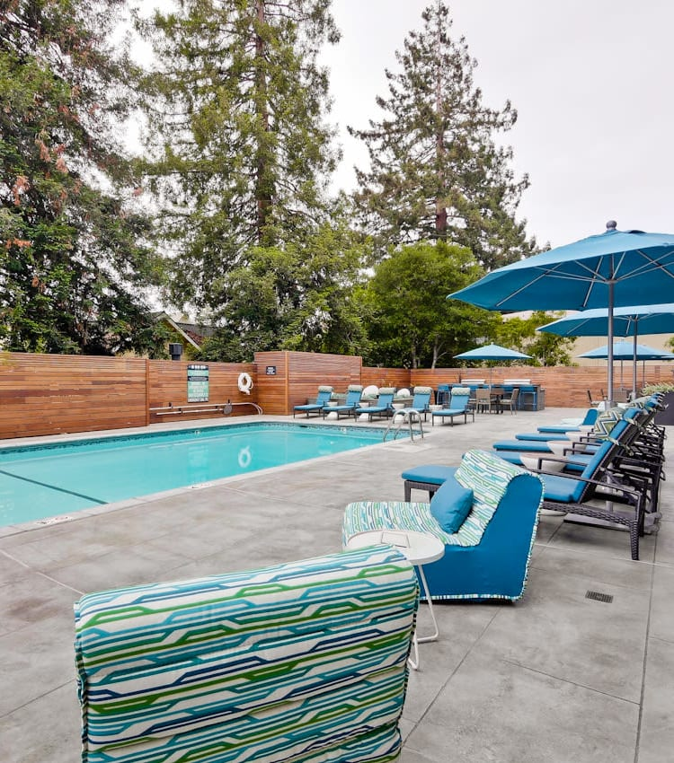 Lounge seating and chaise lounge chairs near the pool at Mia in Palo Alto, California