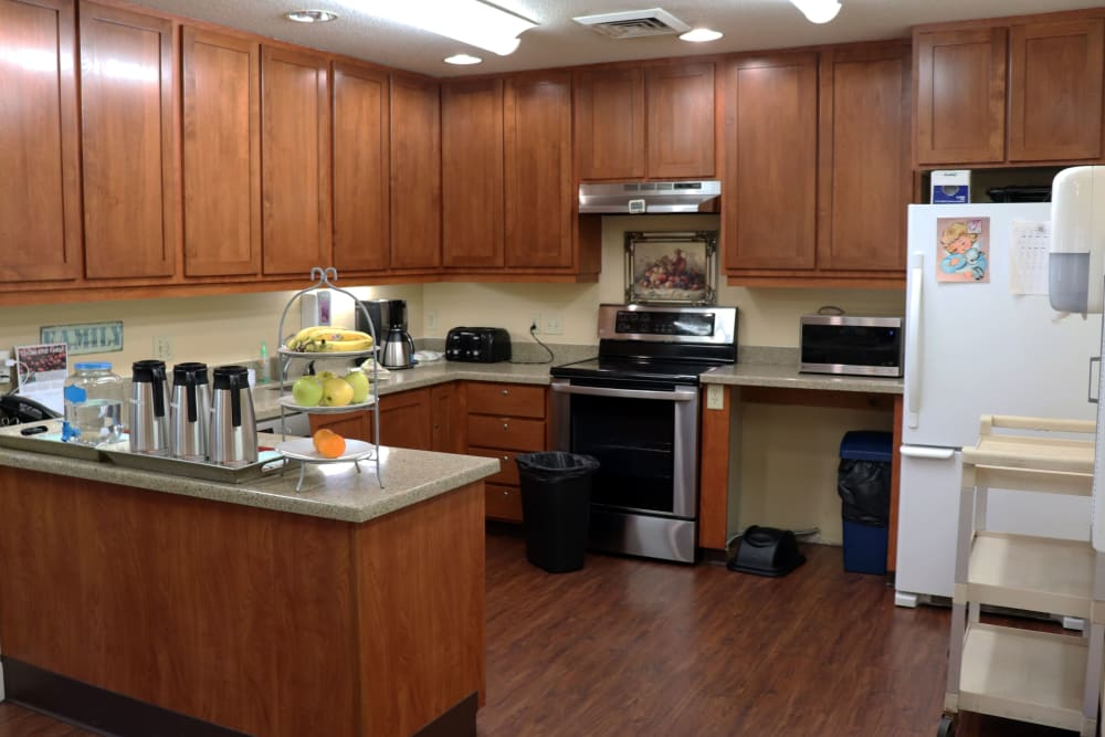 Kitchen inside upscale senior living apartment complete with wood cabinetry at The Springs at Willowcreek in Salem, Oregon