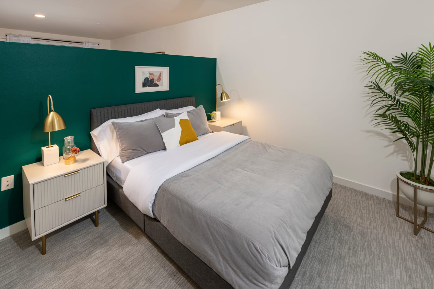 Model apartment bedroom with plenty of natural light at Nightingale in Redmond, Washington