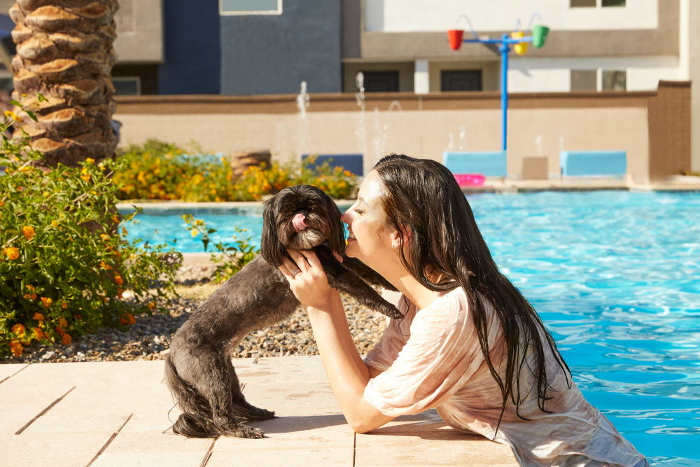 Woman and her dog at Las Casas at Windrose in Litchfield Park, Arizona
