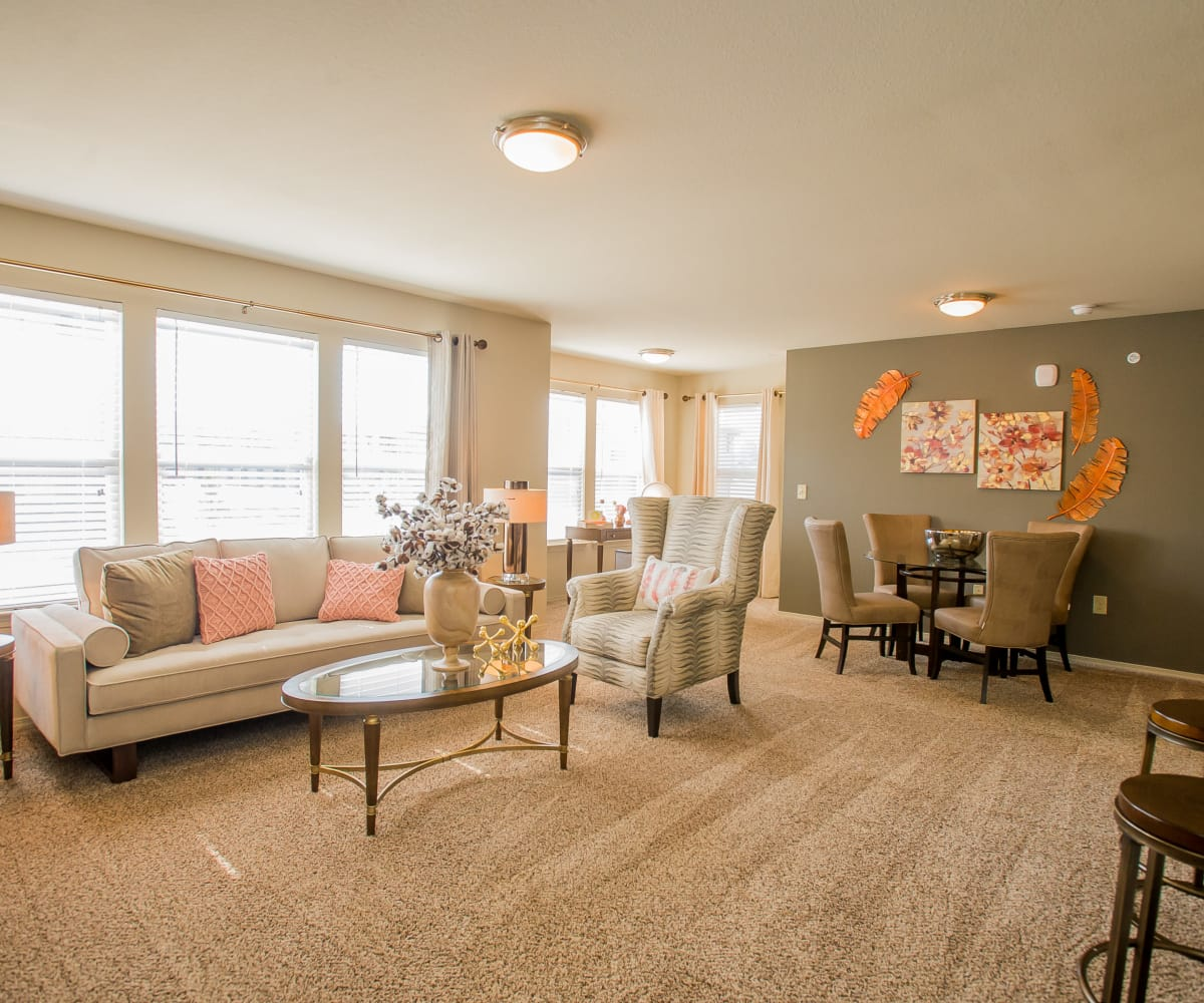 Bright and modern living room Portico at Friars Creek Apartments living room in Temple, Texas