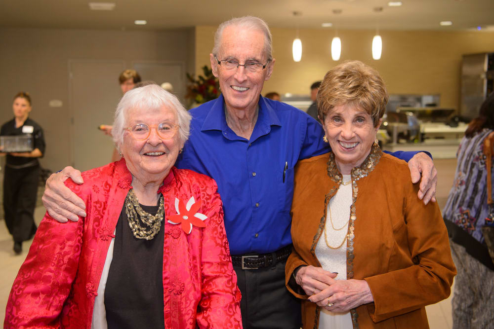Resident friends enjoying a party at Merrill Gardens at Monterey in Monterey, California.