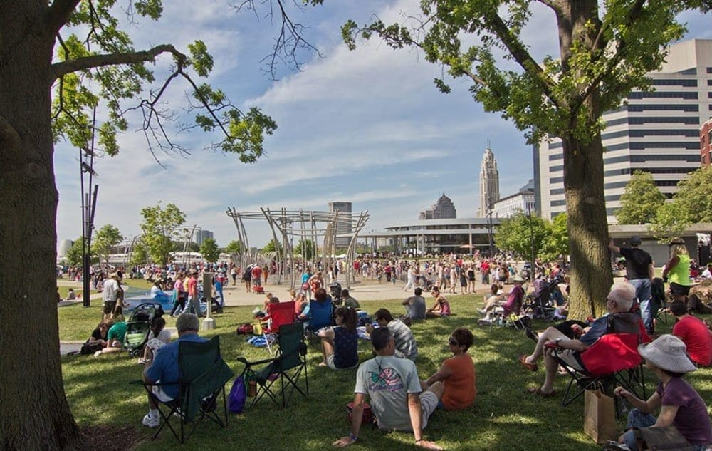 People in a park near Easton Commons in Columbus, Ohio