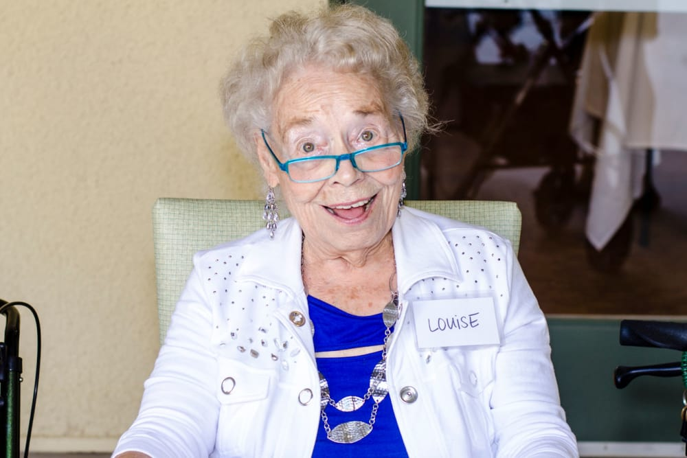 Resident smiling in the sunshine at our senior living community in Henderson, NV