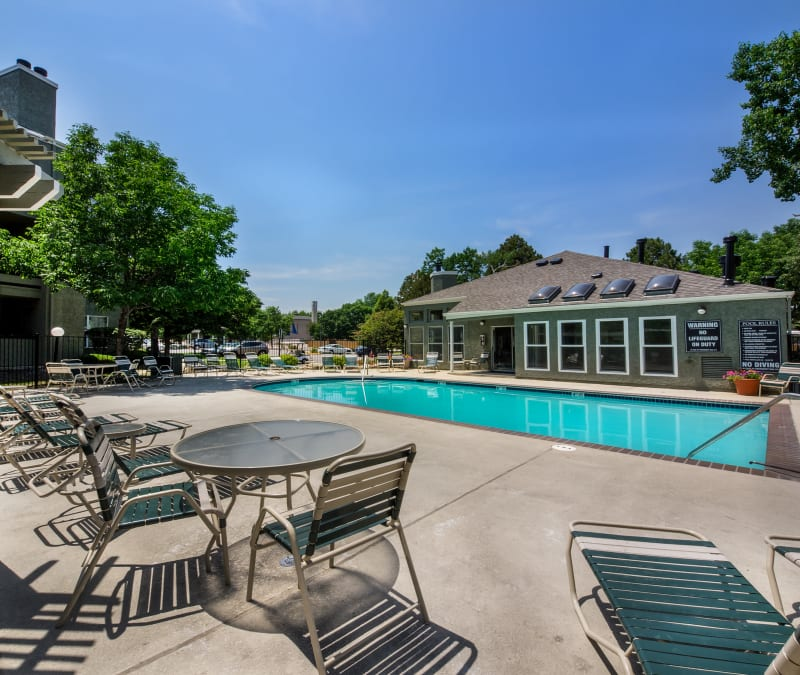 Plenty of seating near the pool at Waterfield Court Apartment Homes in Aurora, Colorado