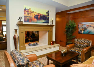 Gorgeous interior common area showcasing fireplace at Merrill Gardens at Solivita Marketplace senior living community