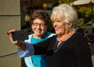 Ladies taking a selfie at our senior living community in Mount Pleasant, SC
