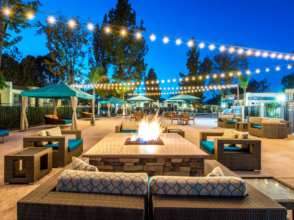 Beautifully designed outdoor common area with a fire pit and lounge at Sofi Poway in Poway, California