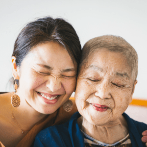 Resident and her younger family member hugging at Sunstone Village in Denton, Texas