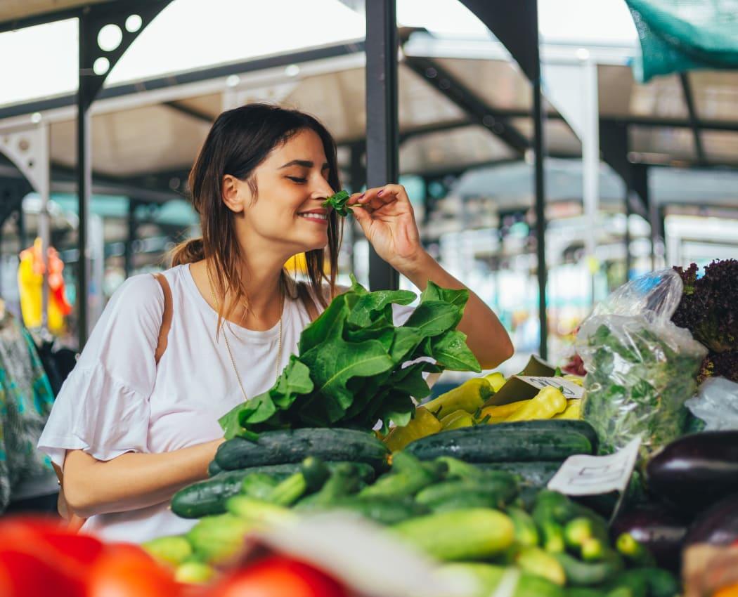 Resident shopping for vegetables at a farmer's market near The Monterey in San Jose, California