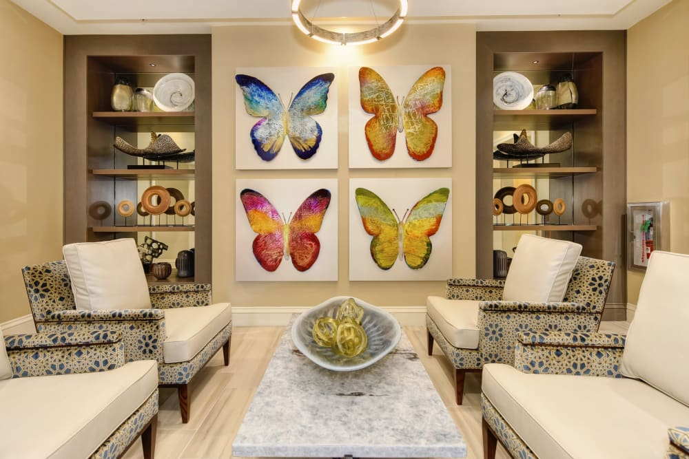 seating area with butterfly paintings