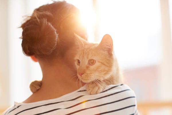 Resident hugging her cat in their new home at Hidden Hills Condominium Rentals in Laguna Niguel, California
