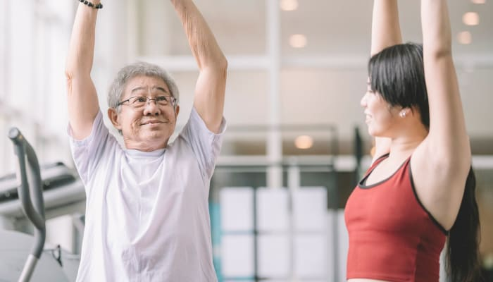 Resident working with a trainer at The Springs at Sherwood in Sherwood, Oregon