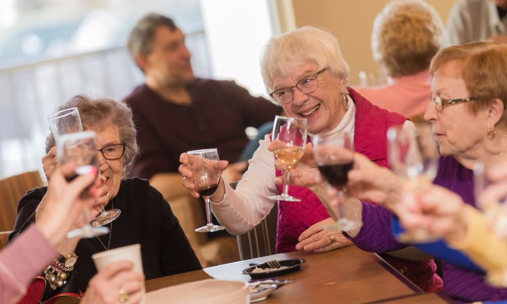 Senior residents toasting