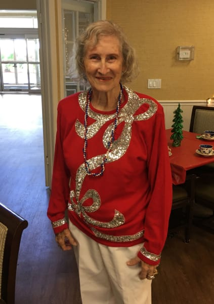 A Barkley Place resident gets in the party spirit as she wears a Christmas themed sweater!