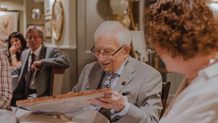 senior man receiving birthday present