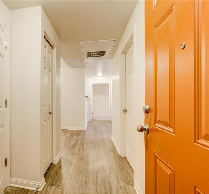 View of the entrance and hallway to a model home at Sierra Oaks Apartments in Turlock, California