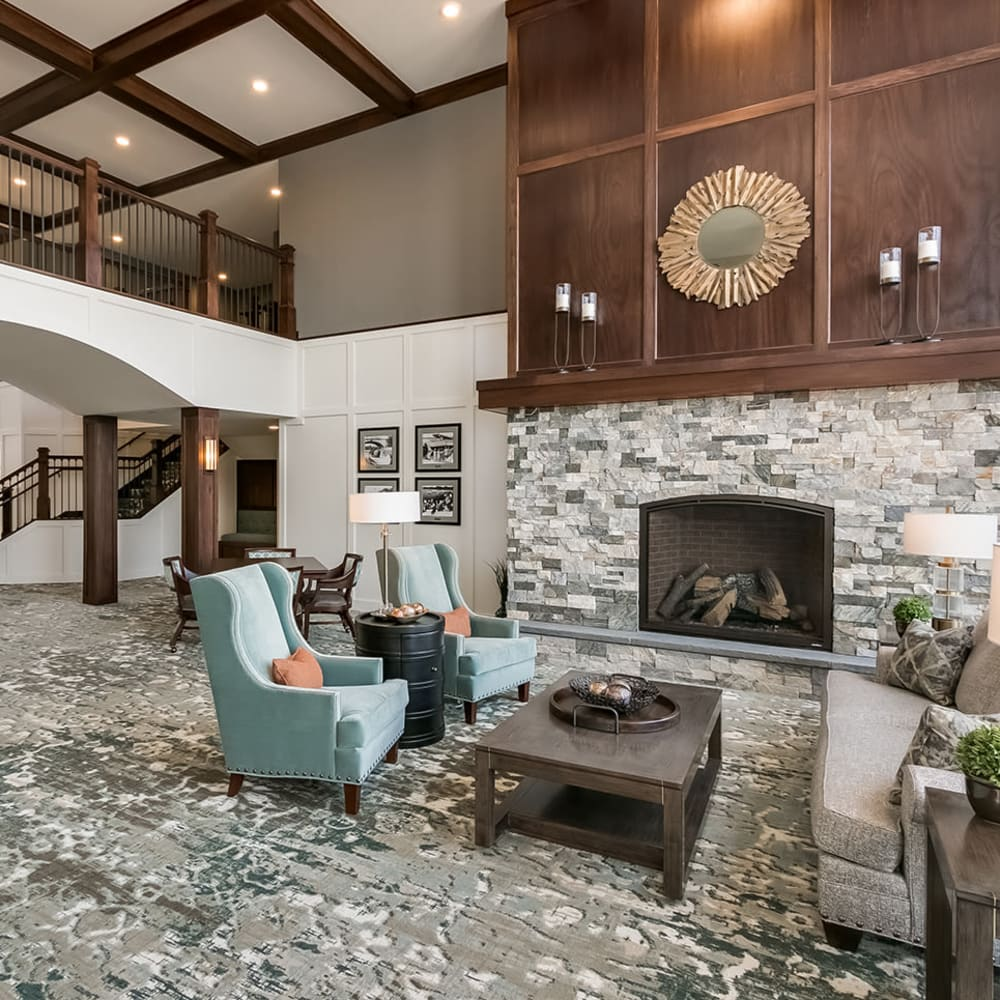 Lobby with a fireplace at Applewood Pointe Prior Lake in Prior Lake, Minnesota.