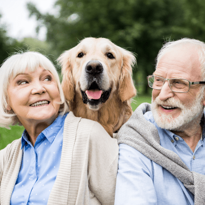 A couple and their dog at Milestone Retirement Communities