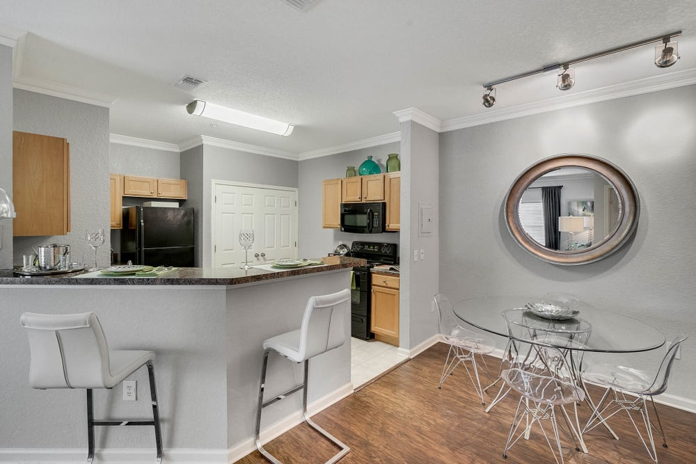 Modern kitchen and dining area at Palms at World Gateway in Orlando, Florida