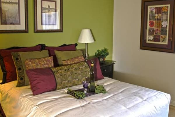 A master bedroom at Lantana Apartments with lots of natural light.