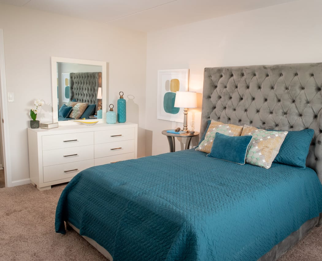 Modern bedroom at Pine Hill Apartments in Wheeling, Illinois