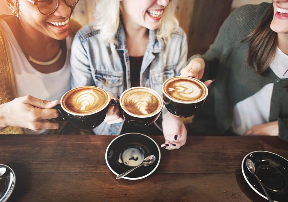 Friends enjoying some coffee together in Irving, Texas near Oaks Hackberry Creek
