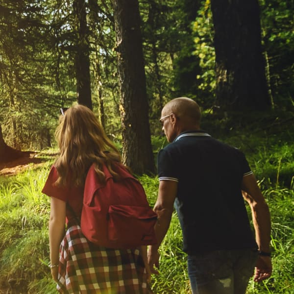 Two people hiking in the forest