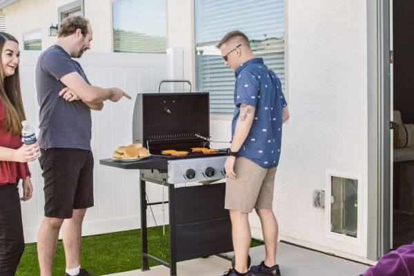 Residents grilling at Christopher Todd Communities At Estrella Commons in Goodyear, Arizona