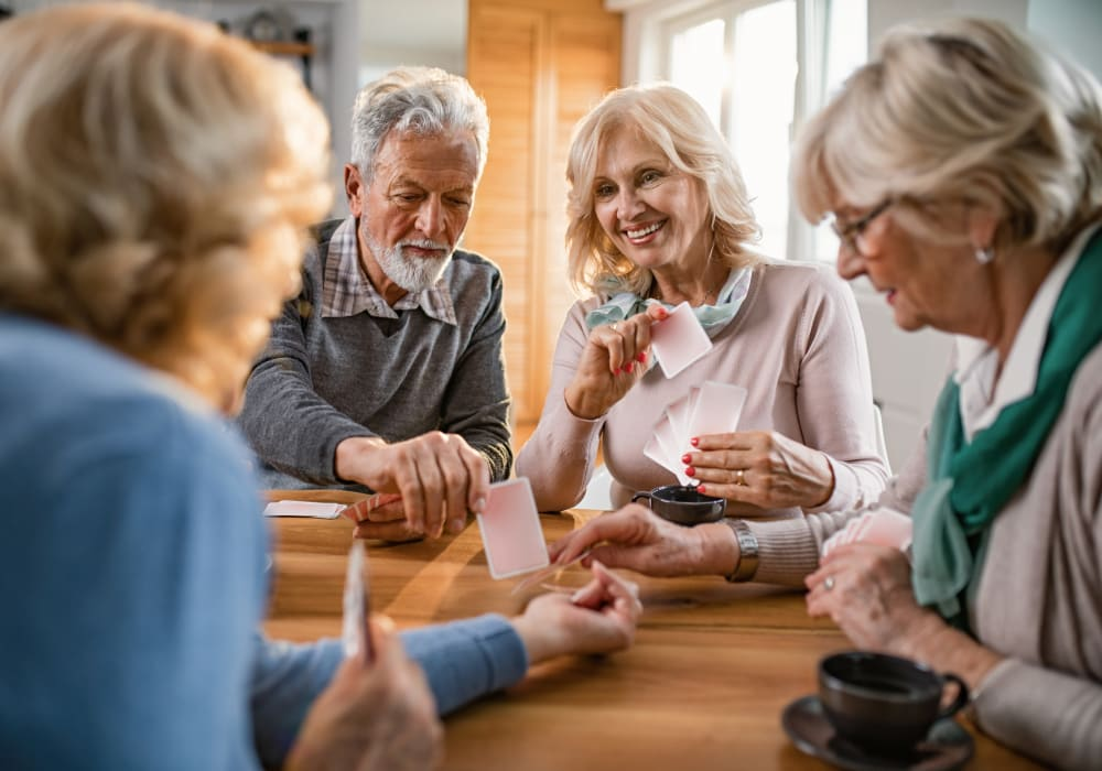 Residents enjoying a card game at Inglenook At Brighton in Brighton, Colorado