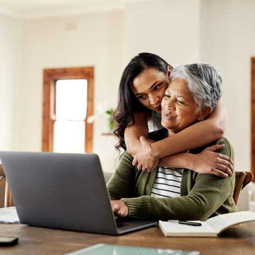A women and her mother renting a unit online from San Marcos Mini Storage