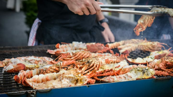 Outdoor grill loaded with crab and lobster near Cape House Apartments in Jacksonville, Florida