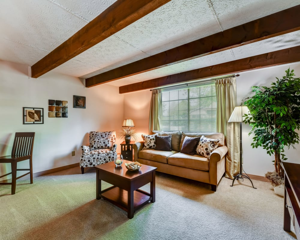 Model living room at Brittany Bay Apartments and Townhomes in Groveport, Ohio