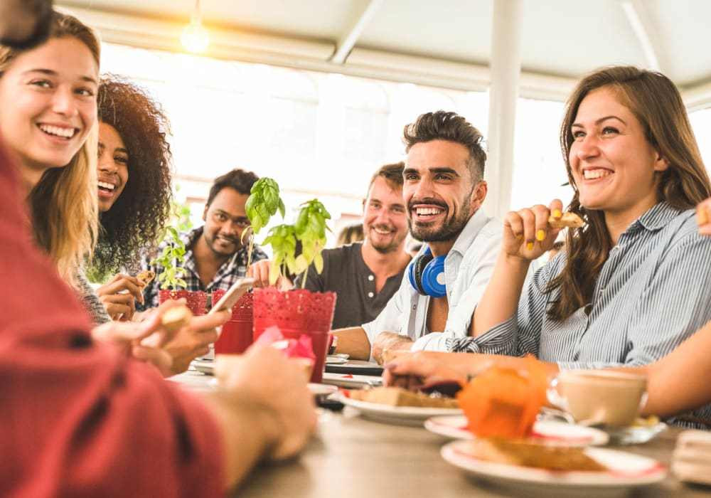 Friends gathered at their favorite local restaurant near Central Station on Orange in Orlando, Florida