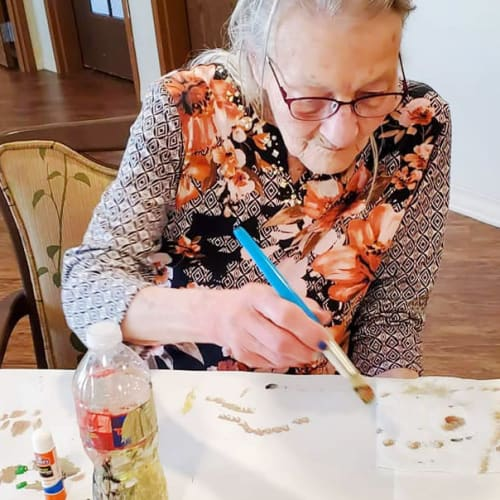 Resident painting at The Oxford Grand Assisted Living & Memory Care in Kansas City, Missouri