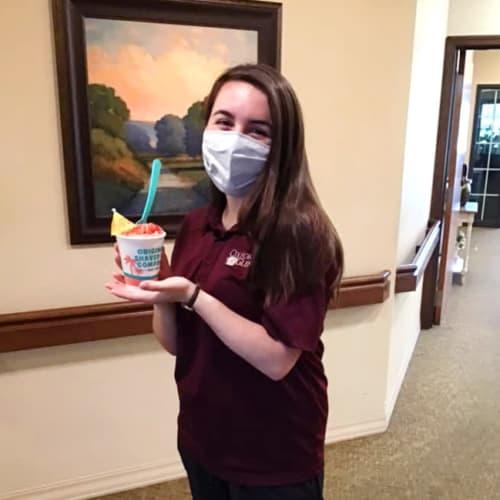 A team member with a sno cone at Oxford Glen Memory Care at Grand Prairie in Grand Prairie, Texas