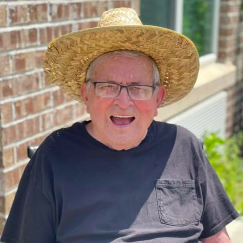 Resident in a hat at Oxford Glen Memory Care at Owasso in Owasso, Oklahoma