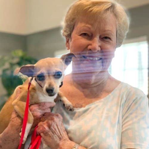 Resident with her dog at Oxford Villa Active Senior Apartments in Wichita, Kansas