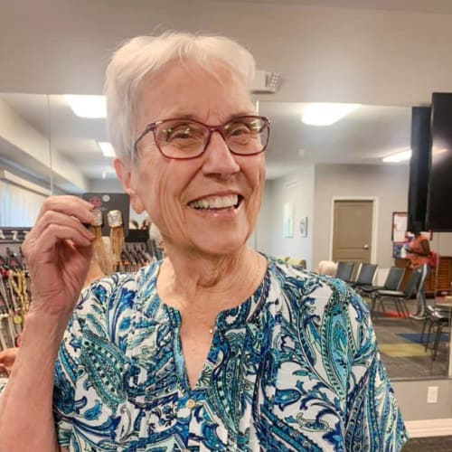 A resident holding earrings at Oxford Villa Active Senior Apartments in Wichita, Kansas