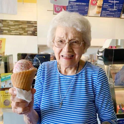 Resident with ice cream at Oxford Villa Active Senior Apartments in Wichita, Kansas