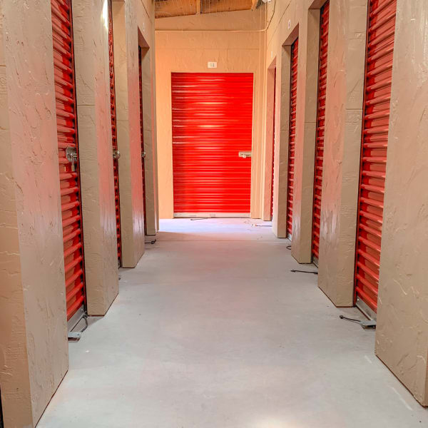 Interior storage units with red doors at StorQuest Self Storage in Lafayette, Colorado